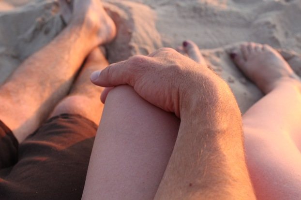 holding hands beach